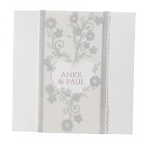 Romantische Vermählungskarte mit transparentem Umleger mit raffinierter Herzstanzung und zarten Blumenmotiven in Silberfolienprägung